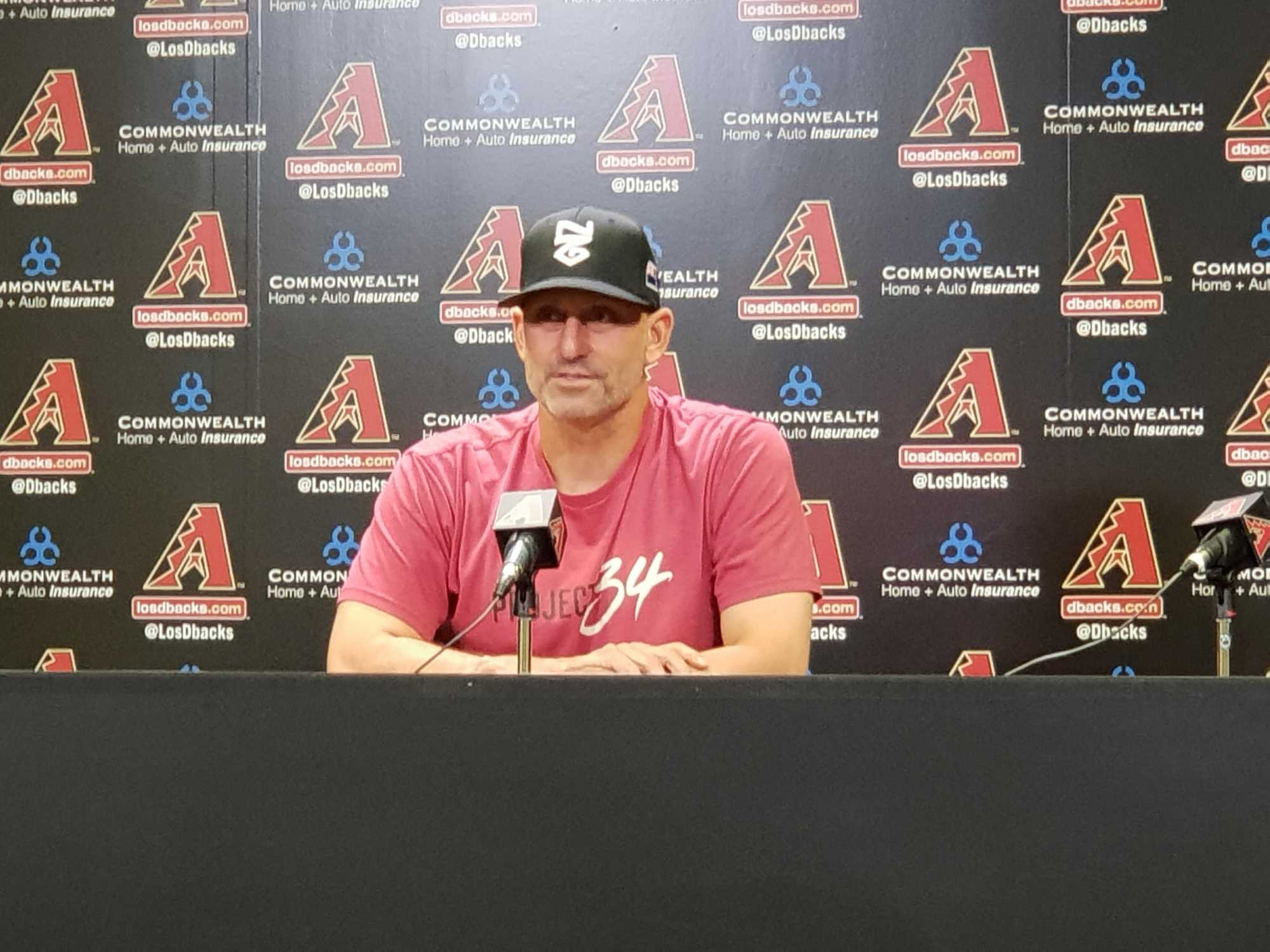 39a20b5c188 D backs Manager Torey Lovullo proudly wears his Baseball New Zealand cap in  Monday s Pre-game Press Conference
